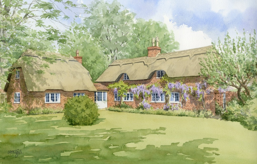 Thatched cottage with wisteria