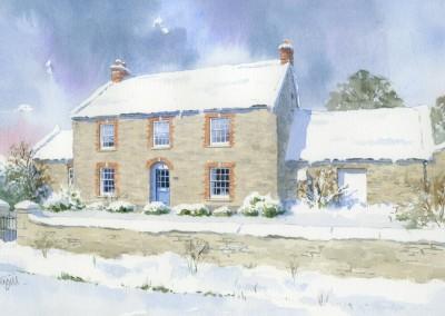 Stone built house as a snowscene
